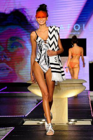 MIAMI BEACH, FL - JULY 23: A model walks the runway at Seafolly Runway Funkshion Swim Fashion Week at Setai Hotel on July 23, 2017 in Miami Beach, Florida.