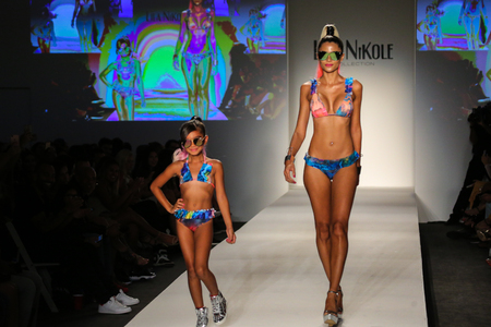 MIAMI BEACH, FL - JULY 22: Models walk the runway at the SWIMMIAMI Lila Nikole 2018 Collection fashion show at the SWIMMIAMI tent on July 22, 2017 in Miami Beach, Florida. Sajtókép
