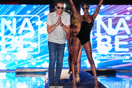 MIAMI, FL - JULY 20: Designer Doug Barry and model walks the runway wearing Nash Beach Beachwear hosted by Planet Fashion TV at SLS Hotel on July 20, 2017 in Miami, Florida.