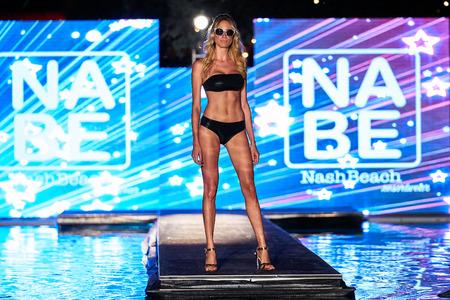 MIAMI, FL - JULY 20: A model walks the runway wearing Nash Beach Beachwear hosted by Planet Fashion TV at SLS Hotel on July 20, 2017 in Miami, Florida.