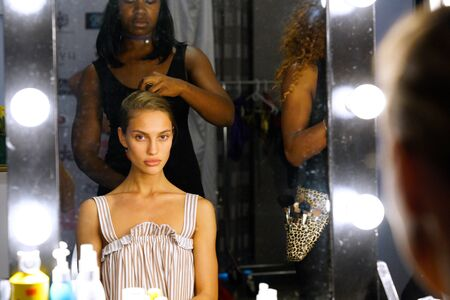 MIAMI, FL - JULY 20: A model getting ready backstage before Revel Rey Fashion Show hosted by Planet Fashion TV at SLS Hotel on July 20, 2017 in Miami, Florida.