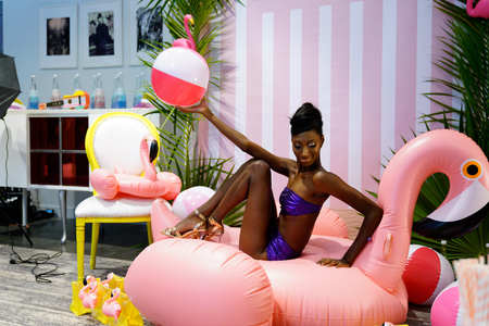MIAMI, FL - JULY 20: A model posing backstage  wearing Nash Beach Beachwear hosted by Planet Fashion TV at SLS Hotel on July 20, 2017 in Miami, Florida.