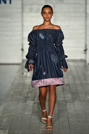 girls at the beach series: MIAMI, FL - JULY 20: A model walks the runway wearing Sea Jasper during the Peroni 6th Annual Emerging Designer Series contest for Funkshion Miami Swim Week on July 20, 2017. Editorial
