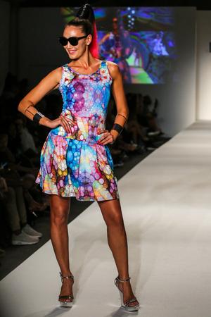 MIAMI BEACH, FL - JULY 22: A model walks the runway at the SWIMMIAMI Lila Nikole 2018 Collection fashion show at the SWIMMIAMI tent on July 22, 2017 in Miami Beach, Florida. Sajtókép