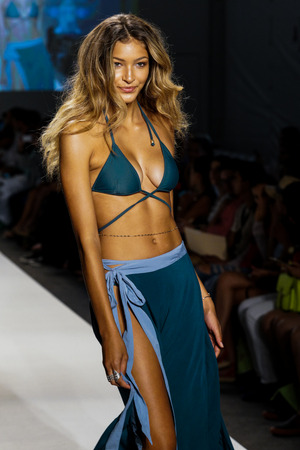 MIAMI BEACH, FL - JULY 23: A model walks the runway during SWIMMIAMI Mia Marcelle 2018 Collection at SWIMMIAMI tent on July 23, 2017 in Miami Beach, Florida.