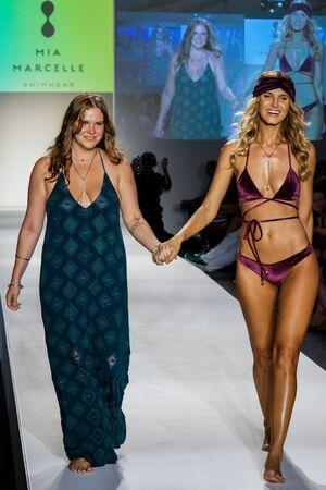 MIAMI BEACH, FL - JULY 23: Designer and model walk the runway during SWIMMIAMI Mia Marcelle 2018 Collection at SWIMMIAMI tent on July 23, 2017 in Miami Beach, Florida. Editorial