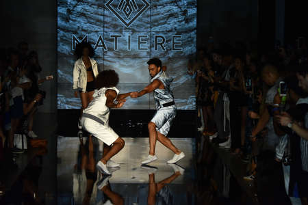 voluminous: NEW YORK, NY - JULY 12: Dancers perform on  the runway at the Matiere show during NYFW: Mens  on July 12, 2017 in New York City. Editorial