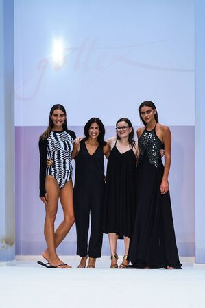 MIAMI BEACH, FL - JULY 22: Designer Keren Gasner and models walk the runway at SWIMMIAMI Gottex Cruise 2018 Fashion Show at WET Deck at W South Beach on July 22, 2017 in Miami Beach, Florida. Editorial