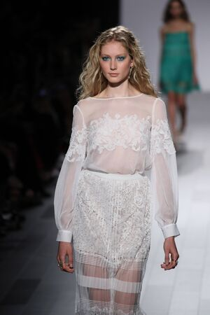NEW YORK, NY - SEPTEMBER 07: A model walks the runway for Tadashi Shoji fashion show during New York Fashion Week on September 7, 2017 in New York City. Editorial