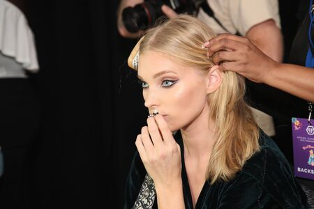 NEW YORK, NY - SEPTEMBER 09: Elsa Hosk getting ready backstage for the Philipp Plein fashion show during New York Fashion Week: The Shows at Hammerstein Ballroom on September 9, 2017 in New York City. Editorial