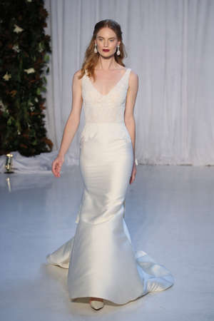 embellishment: NEW YORK - OCTOBER 5: A Model walks the runway for Anne Barge Bridal show FallWinter 2018 Collection during Bridal Fashion Week on October 5, 2017 in New York City. Editorial