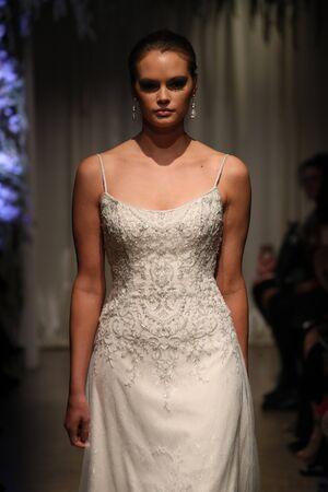 NEW YORK, NY - OCTOBER 04: A model walks the runway wearing Matthew Christopher dresses at NY Bridal Fashion Week at Punto Space 325 W 38th street on October 04, 2017 in New York City. Editorial