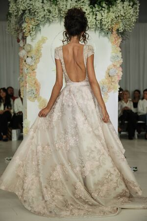 New York, NY, USA - October 7, 2017: A model walks the runway for Julie Vino Havana 2018 Bridal Collection runway show at 404 10th Avenue during New York Bridal week, New York City. Editorial