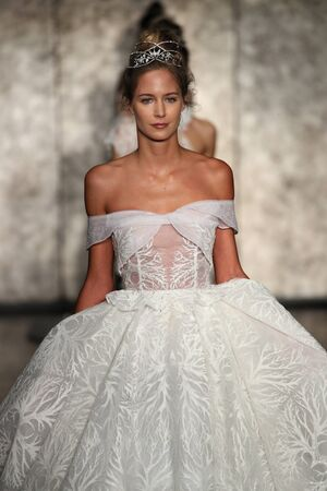 embellishment: NEW YORK - OCTOBER 5: Models walk the runway finale for Inbal Dror Bridal show FallWinter 2018 Collection during Bridal Fashion Week on October 5, 2017 in New York City.