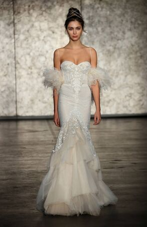 NEW YORK - OCTOBER 5: A Model walks the runway for Inbal Dror Bridal show FallWinter 2018 Collection during Bridal Fashion Week on October 5, 2017 in New York City.