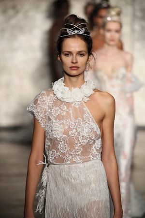 NEW YORK - OCTOBER 5: Models walk the runway finale for Inbal Dror Bridal show FallWinter 2018 Collection during Bridal Fashion Week on October 5, 2017 in New York City.