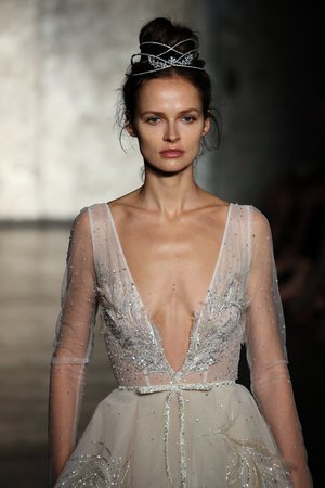 embellishment: NEW YORK - OCTOBER 5: A Model walks the runway for Inbal Dror Bridal show FallWinter 2018 Collection during Bridal Fashion Week on October 5, 2017 in New York City.