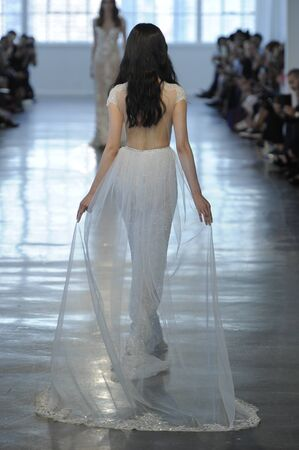 New York, NY, USA - October 6, 2017: A model walks the runway at the Berta Bridal 2018 Collection runway show during New York Bridal week, New York City. Editorial