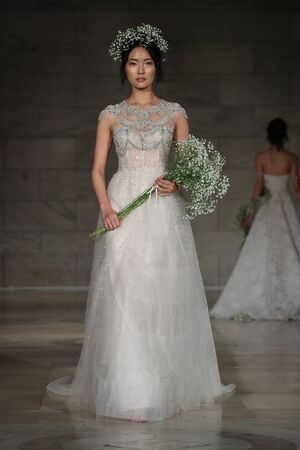 NEW YORK - OCTOBER 5: A model walks the runway for Reem Acra  Bridal show FallWinter 2018 Collection during Bridal Fashion Week on October 5, 2017 in New York City.