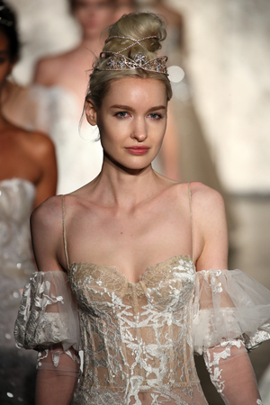 NEW YORK - OCTOBER 5: Models walk the runway finale for Inbal Dror Bridal show Fall/Winter 2018 Collection during Bridal Fashion Week on October 5, 2017 in New York City.