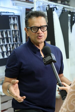 New York, NY, USA - October 6, 2017: Designer Naeem Khan giving away interview backstage before the Naeem Khan Bridal 2018 Collection runway show during New York Bridal week, New York City. Editorial