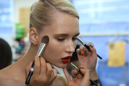 couture: New York, NY, USA - October 6, 2017: A model getting ready backstage before the Naeem Khan Bridal 2018 Collection runway show during New York Bridal week, New York City.