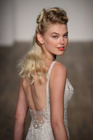 NEW YORK - OCTOBER 6: A model walks the runway for Blush by Hayley Paige  Bridal show FallWinter 2018 Collection during Bridal Fashion Week on October 6, 2017 in New York City. Editorial