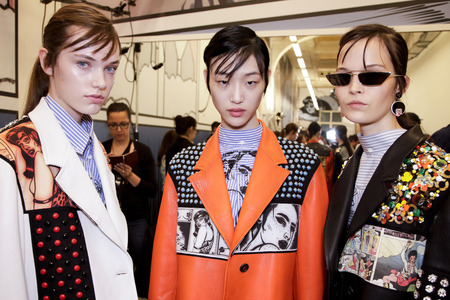 MILAN, ITALY - SEPTEMBER 21: Models are seen backstage before the Prada show during Milan Fashion Week SpringSummer 2018 on September 21, 2017 in Milan, Italy. Editorial