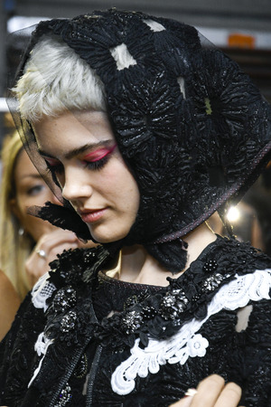 MILAN, ITALY - SEPTEMBER 23: A model is seen backstage ahead of the Antonio Marras show during Milan Fashion Week SpringSummer 2018 on September 23, 2017 in Milan, Italy.