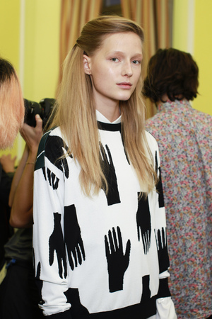 MILAN, ITALY - SEPTEMBER 21: A model is seen backstage ahead of the Arthur Arbesser show during Milan Fashion Week SpringSummer 2018 on September 21, 2017 in Milan, Italy. Editorial