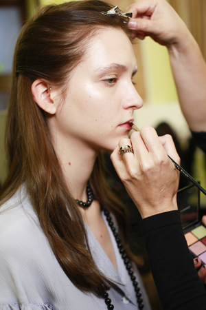 MILAN, ITALY - SEPTEMBER 21: A model getting ready backstage ahead of the Arthur Arbesser show during Milan Fashion Week SpringSummer 2018 on September 21, 2017 in Milan, Italy.