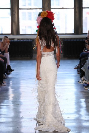 NEW YORK, NY - APRIL 14: A model walks the runway during the Watters Spring 2019  Bridal fashion show on April 14, 2018 in New York City.