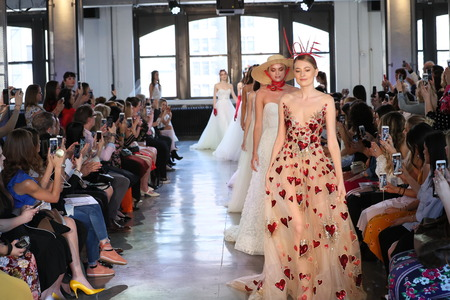 NEW YORK, NY - APRIL 14: Models walk the runway finale during the Watters Spring 2019  Bridal fashion show on April 14, 2018 in New York City. Editorial