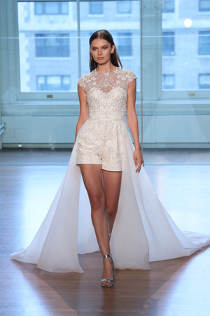 NEW YORK, NY - APRIL 13: A model walks the runway for the Justin Alexander Spring 2019  Bridal Fashion show on April 13, 2018 in New York City.