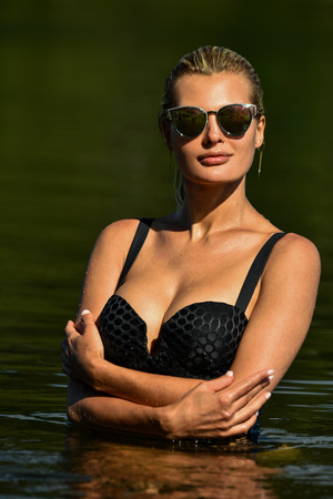 Glamor bikini model, outdoor beauty portrait at the lake.