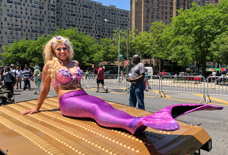 NEW YORK, NY - JUNE 16: People participate in the 36th annual Mermaid Parade in Coney Island on June 16, 2018 in New York City.