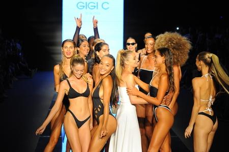 MIAMI BEACH, FL - JULY 14: Designer Gigi Caruso and models walk the runway for Gigi C Bikinis during the Paraiso Fashion Fair at The Paraiso Tent on July 14, 2018 in Miami Beach, Florida. Editorial