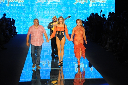 MIAMI BEACH, FL - JULY 14: Lourdes Hanimian, Agueda Lopez and Augusto Hanimian walk the runway for Luli Fama during the Paraiso Fashion Fair at The Paraiso Tent on July 14, 2018 in Miami Beach, Florida. Editorial