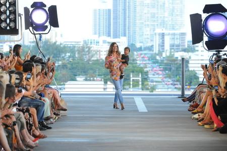 MIAMI, FL - JULY 14: Designer Naomi Acacia Newirth and her kid walks the runway for Acacia Resort 2019 during Paraiso Fashion Fair at 1111 Lincoln Road on July 14, 2018 in Miami, Florida.