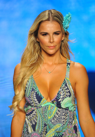 MIAMI BEACH, FL - JULY 14: Agueda Lopez walks the runway for Luli Fama during the Paraiso Fashion Fair at The Paraiso Tent on July 14, 2018 in Miami Beach, Florida.