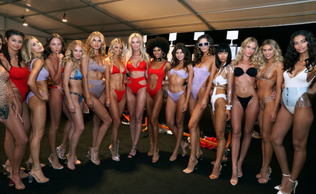 MIAMI BEACH, FL - JULY 12: Designer and models posing backstage before Monica Hansen Show during the Paraiso Fashion Fair at The Paraiso Tent on July 12, 2018 in Miami Beach, Florida. Editorial