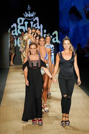MIAMI BEACH, FL - JULY 13: Designers Catalina Álvarez and Mariana Hinestroza and models walk the runway for Agua Bendita during the Paraiso Fashion Fair at The Paraiso Tent on July 13, 2018 in Miami Beach, Florida.
