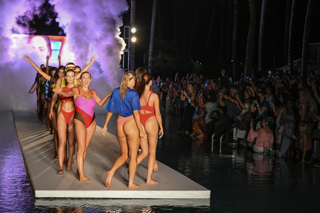 MIAMI, FL - JULY 15: Models walk the runway finale for the 2018 Sports Illustrated Swimsuit show at PARAISO during Miami Swim Week at The W Hotel South Beach on July 15, 2018 in Miami, Florida. Editorial