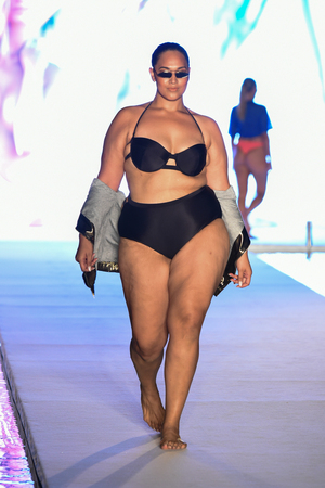 MIAMI, FL - JULY 15: A model walks the runway for the 2018 Sports Illustrated Swimsuit show at PARAISO during Miami Swim Week at The W Hotel South Beach on July 15, 2018 in Miami, Florida.