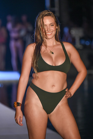 MIAMI, FL - JULY 15: A model walks the runway for the 2018 Sports Illustrated Swimsuit show at PARAISO during Miami Swim Week at The W Hotel South Beach on July 15, 2018 in Miami, Florida. Archivio Fotografico - 109959255