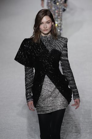 PARIS, FRANCE - MARCH 02: A model walks the runway during the Balmain show as part of the Paris Fashion Week Womenswear FallWinter 20182019 on March 2, 2018 in Paris, France. Editorial