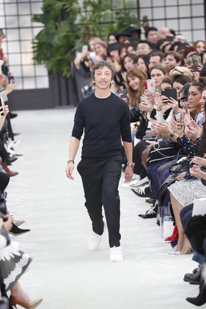 PARIS, FRANCE - MARCH 04: Fashion designer Pierpaolo Piccioli walk the runway after the Valentino show as part of the Paris Fashion Week Womenswear FallWinter 20182019 on March 4, 2018 in Paris, France.