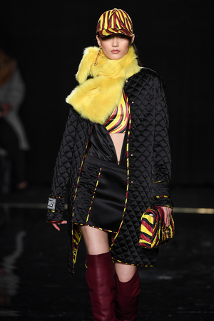 NEW YORK, NEW YORK - DECEMBER 02: Liu Chunjie walks the runway at the Versace Pre-Fall 2019 Collection at The American Stock Exchange on December 02, 2018 in New York City.