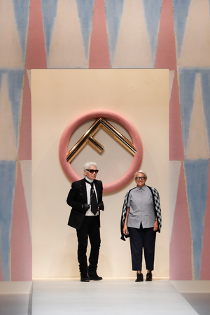 MILAN, ITALY - SEPTEMBER 21: Designer Karl Lagerfeld and Silvia Venturini Fendi acknowledging the applause of the public after the Fendi show during Milan Fashion Week Spring/Summer 2018 on September 21, 2017 in Milan, Italy. Stock Photo - 114454041