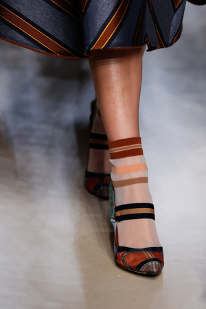 MILAN, ITALY - SEPTEMBER 21: A model walks the runway at the Fendi show during Milan Fashion Week SpringSummer 2018 on September 21, 2017 in Milan, Italy.